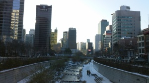 The stream used to be a road, the tall buildings of Myeong-dong surround it.